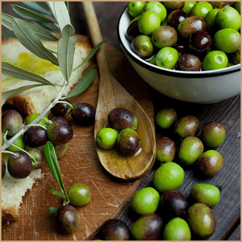 Montalbano olives on wooden board